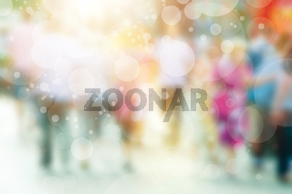 Blurred image of crowd of busy people walking on the street. Blur background