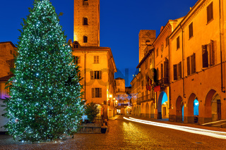 Illuminated Christmas tree on town square in Alba
