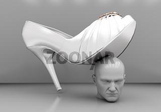 Man's head under a female heel