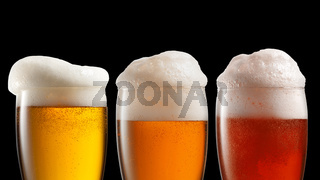 Different beer in glasses isolated on black