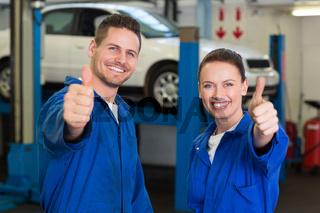 Team of mechanics smiling at camera