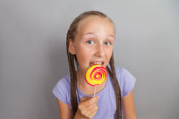 happy girl with lollipop