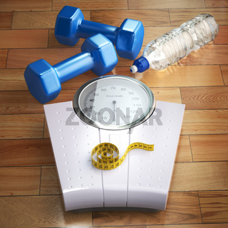 Fitness and weight loss concept. Weigh scales, dumbells and measuring tape.