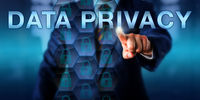 Businessman Pressing DATA PRIVACY On A Screen