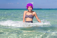 cheerful woman in retro swimsuit playful in the sea
