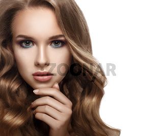 Close-up portrait of a beautiful girl with curly hair