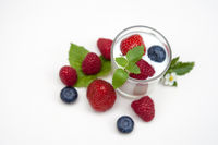 Natural yogurt with fresh berries mixed  isolated on withe