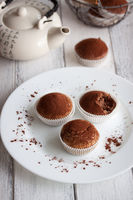 Muffins with spelt flour and cocoa in a wooden box on a table