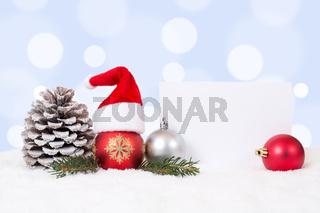 Weihnachtskarte mit Mütze Weihnachten Dekoration mit Schnee und Textfreiraum