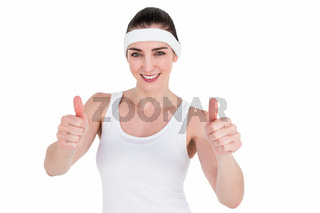 Female athlete showing thumbs up
