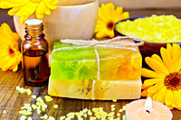 Soap homemade and oil with calendula on board