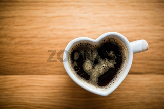 Black coffee, espresso in heart shaped cup. Love, Valentine#39;s Day, vintage