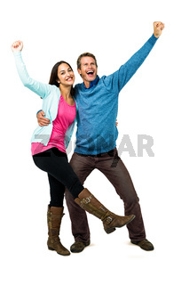 Happy successful couple with hands raised