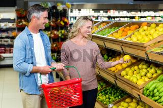 Happy smiling couple picking lemon