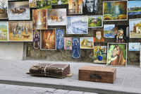 Paintings for sale displayed on city wall next to Florianska Gate Krakow Poland