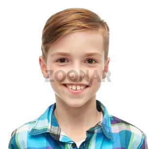 smiling boy in checkered shirt