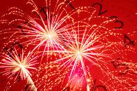 twelve oclock and red firework