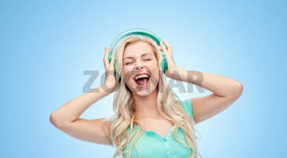 happy young woman or teenage girl with headphones