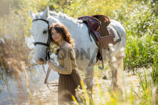 Beautiful girl with the white horse