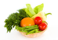 Fresh vegetables in the basket isolated over white