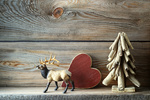 Christmas tree decorations on wooden shelf