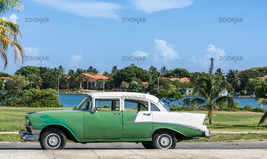 Green american Oldtimer with white roof in Cuba Varadero