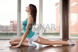 Young smiling woman doing yoga