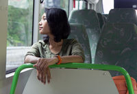 woman ridding in the empty bus