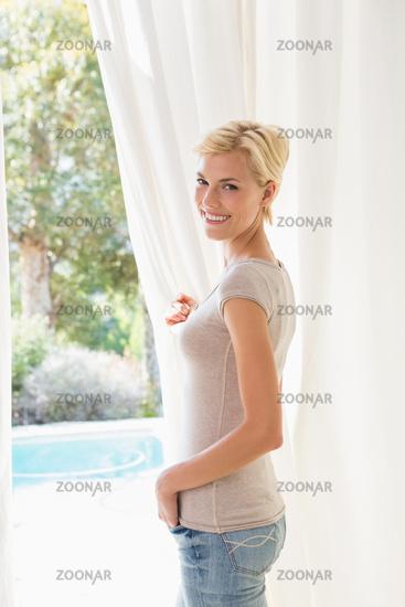 Portrait smiling blonde woman look outside