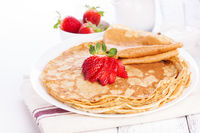 Staple of wheat golden yeast pancakes or crepes