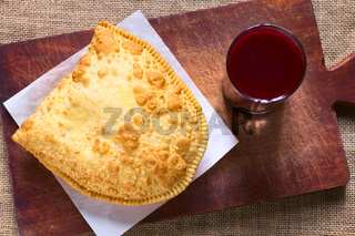 Pastel, a Bolivian Snack with Api, a Purple Corn Beverage