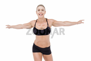 Female athlete raising arms