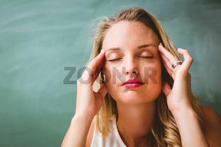 Beautiful businesswoman with headache