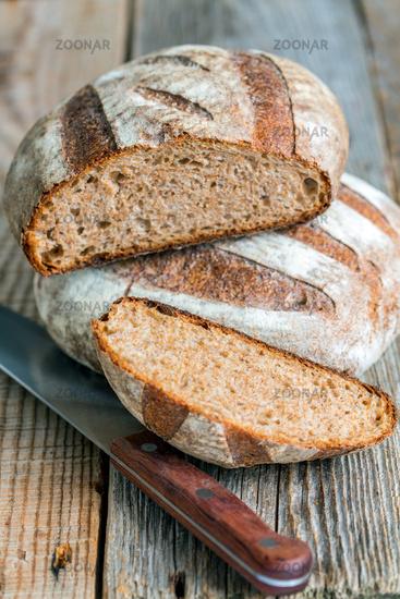 Fresh homemade bread and knife.