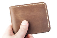 brown leather wallet in hand isolated on white