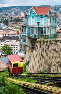 VALPARAISO, CHILE - OCT 20: Passenger carriage of funicular railway (one of the oldest in the world) goes up near the houses of historical shell, declared World Heritage by UNESCO – on October 20, 2015 in Valparaiso, Chile