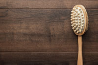 wooden massager brush on the table