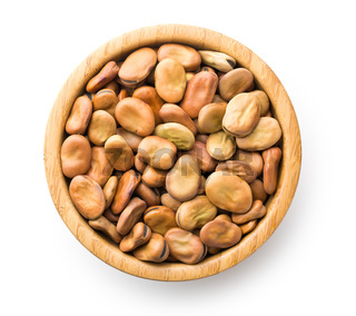 dried broad beans in wooden bowl