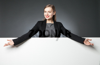 Portrait of confident woman with red lips and wide arms