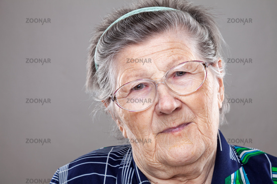 Closeup portrait of an elderly woman with glasses
