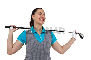 Golf player holding a golf club and golf ball