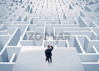 Businessman staring at infinite maze
