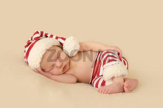 Baby mit Nikolausmuetze Weihnachten