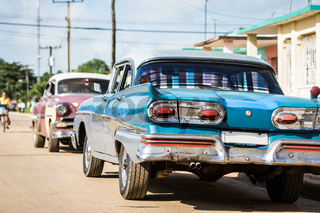 American Oldtimer parked in the countryside Cuba