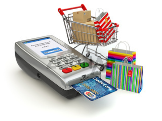 Shopping online concept. Pos terminal with credit card and shopping cart and bag with purchases.