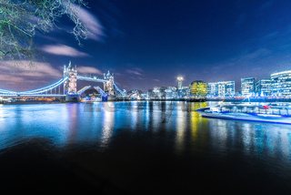 TowerBridge, bridge lift opening at night on River Thames, London, United Kingdom