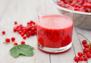 Fresh and healthy red currant smoothie in a glass