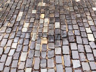 old wet granite cobblestone street in the rain
