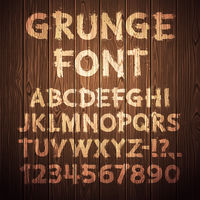 Grunge Letters and Numbers on Wooden Background