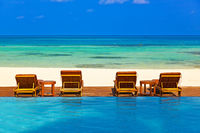Loungers and pool on Maldives beach